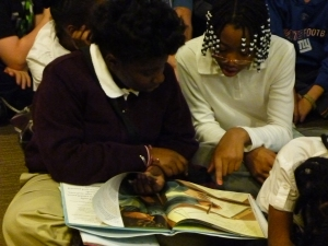 While waiting for the presentation to begin students passed the time reading and discussing Doreen's book.