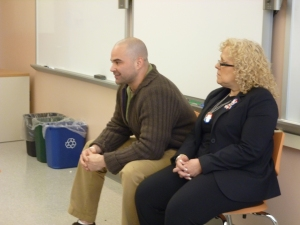 Omar and Emily listen to a student's question