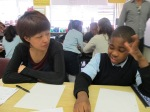 A BtB writing mentor helps this PS 76 student think hard!