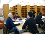 BtB Mentor Brian works with a small group of 10th graders at CHAH.