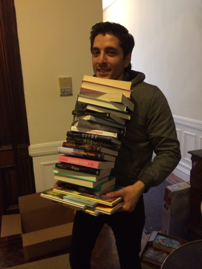 Here's Alex, our Program Intern, struggling to carry some of the books. Careful Alex- don't trip and fall!